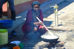 Woman-cooks-for-her-family-in-Ayweyo